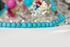 Jewels on the light gray background. Turquoise Royalty Free Stock Images
