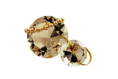 Jewels, pearls and gold. Diamond with facets that sparkle brightly in the light with pearls and gold Stock Image