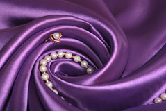 Jewels on purple satin Royalty Free Stock Image