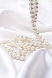 Jewels on white satin Royalty Free Stock Photos