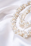 Jewels on white satin Royalty Free Stock Images
