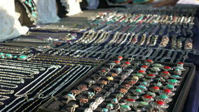Jewerly on Stand. Various jewerly objects exposed on table for selling on a summer bargain stock footage