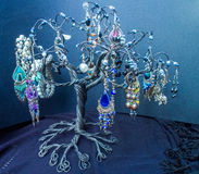 Jewerly Tree on Black Background. Earrings on jewerly tree. Black Background Stock Photo