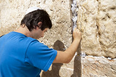 Placing a Note in the Wailing Wall Royalty Free Stock Image