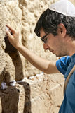Placing a Note in the Wailing Wall Stock Photography
