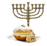 Jewish attributes for Hanukkah. Menorah, donuts and dreidel are traditional attributes for holiday of Hanukkah Stock Images