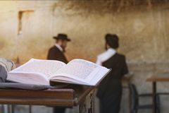 Jewish bible on table, wailing western wall, jerusalem, israel. book of the Torah-the Pentateuch of Moses is open on the prayer. Table on the background of royalty free stock images