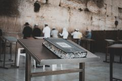 Jewish bible on table, wailing western wall, jerusalem, israel. book of the Torah-the Pentateuch of Moses on the prayer table on. The background of praying royalty free stock image
