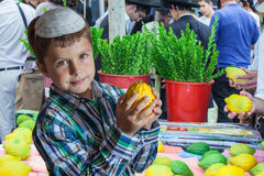 The Jewish boy in white skullcap with etrog Royalty Free Stock Image