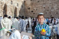 Jewish boy in white skullcap. The greatest shrine of Judaism is the Western Wall of the Temple. Autumn Jewish holiday Sukkot. Beautiful Jewish boy in white Stock Image