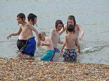 Jewish boys at seaside Stock Photos