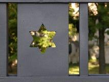 Jewish cemetery 2. Jewish cemetery through the paling, Prague, Zizkov, Czech republic Royalty Free Stock Photo