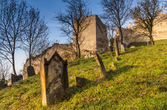 Jewish cemetery below medieval castle Beckov. Afternoon at the cemetery in Slovakia, Trencin, village Beckov Stock Image
