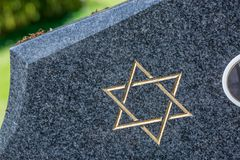 Jewish cemetery: Star of David on the tombstone. Jewish cemetery: closeup on Star of David on the tombstone stock images