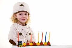Jewish Child. Young blond hair three year old boy lighting the candles in the Jewish tradition to celebrate Hanukkah