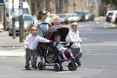 Jewish children. Children in traditional dress are walking in the street at Mea She'Arim, the jewish orthodox district in Jerusaelm, Israel. Mea Shearim is one Royalty Free Stock Photos
