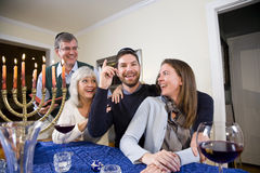 Jewish family celebrating Chanukah stock images