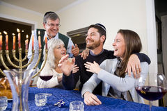 Jewish family celebrating Chanukah Royalty Free Stock Image