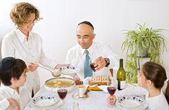 Jewish family celebrating passover Stock Photos