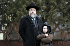 Jewish family. In the photo. Son firmly holds the Talmud. Photo made in Lviv Royalty Free Stock Photo