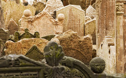 Jewish Gravestones In Prague. Gravestones in the historic cemetery in the Josefov ghetto area of central Prague tilt and lean together as they have settled over Royalty Free Stock Photography