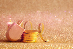 Jewish Hanukkah with dreidel (spinning top) and chocolate coins. Image of jewish holiday Hanukkah with wooden dreidel (spinning top) and chocolate coins on the Royalty Free Stock Image