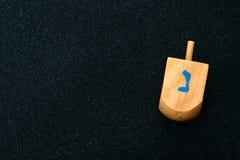 jewish Hanukkah with wooden dreidel (spinning top) Stock Photo