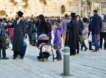 Jewish hasidic pray a the Western Wall of Old City of Jerusalem. JERUSALEM, ISRAEL - DECEMBER 26, 2016: Jewish hasidic pray a the Western Wall, Wailing Wall the Stock Photo
