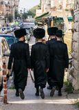 Jewish hassidic walking on the street. royalty free stock images