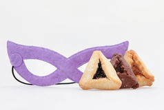 Jewish holiday food Purim Hamantaschen and mask Stock Photos