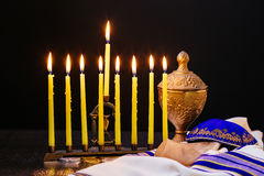 Jewish holiday hannukah with menorah traditional. Jewish holiday hannukah low key image of jewish holiday Hanukkah with menorah traditional Candelabra and wooden Royalty Free Stock Photo