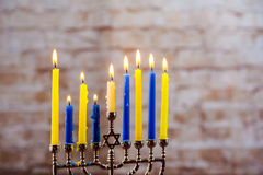 Jewish holiday hannukah with menorah traditional. Jewish holiday hannukah low key image of jewish holiday Hanukkah with menorah traditional Candelabra and wooden Stock Images