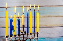 Jewish holiday hannukah with menorah traditional. Jewish holiday hannukah low key image of jewish holiday Hanukkah with menorah traditional Candelabra and wooden Royalty Free Stock Photography