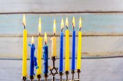 Jewish holiday hannukah with menorah traditional. Jewish holiday hannukah low key image of jewish holiday Hanukkah with menorah traditional Candelabra and wooden Royalty Free Stock Image