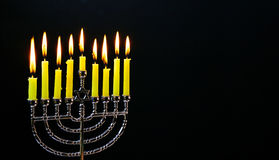 Jewish holiday hannukah with menorah traditional. Jewish holiday hannukah low key image of jewish holiday Hanukkah with menorah traditional Candelabra and wooden Stock Image