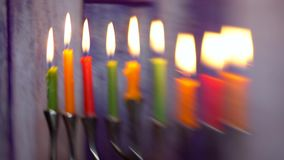 Jewish holiday hannukah symbols - menorah defocused lights Selective soft focus. Jewish holiday hannukah symbols - menorah. defocused lights Copy space stock footage