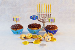 Jewish holiday hannukah symbols - menorah, donuts, chocolate coins. And wooden dreidels jewish holiday Hanukkah with menorah Stock Image