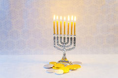 Jewish holiday hannukah symbols - menorah, donuts, chocolate coins. And wooden dreidels jewish holiday Hanukkah with menorah Royalty Free Stock Photography