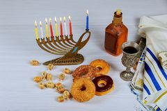 Jewish holiday hannukah symbols - menorah, doughnuts, chockolate coins and wooden dreidels. Copy space background Stock Images