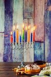 Jewish holiday hannukah symbols - menorah, doughnuts, chockolate coins and wooden dreidels. Copy space background Royalty Free Stock Image
