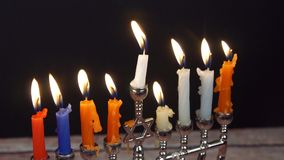 Jewish holiday hannukah symbols - menorah,. Hanukah candles celebrating the Jewish holiday Hanukkah celebration stock video