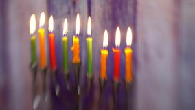 Jewish holiday hannukah symbols - menorah Selective soft focus. Jewish holiday hannukah symbols - menorah. Copy space background. Selective soft focus stock footage