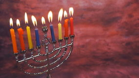 Jewish holiday hannukah symbols - menorah and wooden dreidels. Hannukah, holiday, jewish stock footage