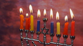 Jewish holiday hannukah symbols - menorah and wooden dreidels. Hannukah, holiday, jewish stock video footage