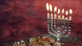 Jewish holiday hannukah symbols - menorah and wooden dreidels.