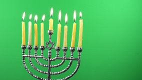 Jewish holiday hannukah symbols - menorah and wooden dreidels. Hannukah, holiday, jewish stock video
