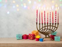 Jewish holiday Hanukkah background. With menorah and gift boxes