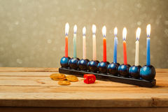 Jewish Holiday Hanukkah background with menorah over blur background Stock Photography