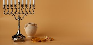 Jewish holiday Hanukkah background with menorah, spinning top,coins and jug stock photography