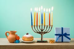 Jewish holiday Hanukkah background with menorah, sufganiyot, gif stock photo